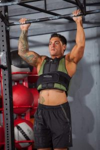 crossfit doing pullups with humanx vest