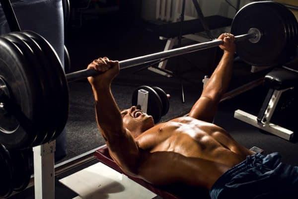 power athletic guy , execute exercise press with weight