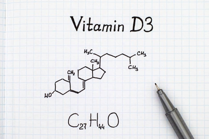 Chemical formula of Vitamin D3 with pen.