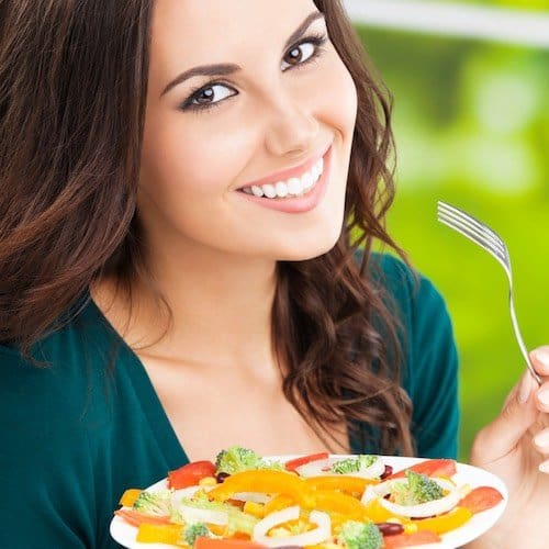 happy smiling woman with salad